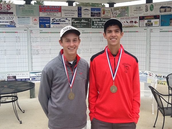 Effingham's Reed Schafer and Jackson Wendling pose with their All-Conference medals at the Apollo Conference tournament.