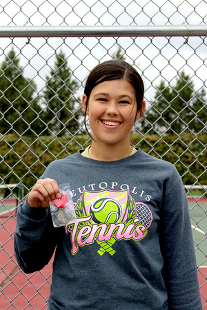 Teutopolis' Kaitlin Deters shows off her medal after qualifying for state at the St. Anthony Sectional.
