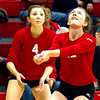 St. Anthony's Isabel Moore (4) looks on as Marci Mills (12) prepares to set a ball during the Bulldogs' two-set win at the Class 1A Neoga Regional.