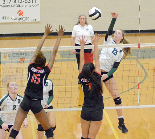 Addie Ashton goes up for a kill against North Central on Monday, Oct. 3.