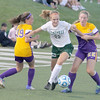 Zionsville's Erin Patterson splits two defenders in the first half on Thursday night.