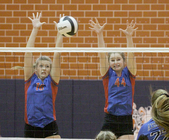 Western Boone's Talyn Guinn (left) and Callie Gubera go up to block a Crawfordsville attempt in the first set on Thursday.