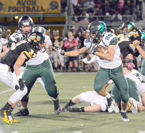 Brenden Mikesell stiff arms an Avon player on Friday night.