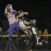Logan Benson makes a leaping catch in the third quarter on Friday for Western Boone.