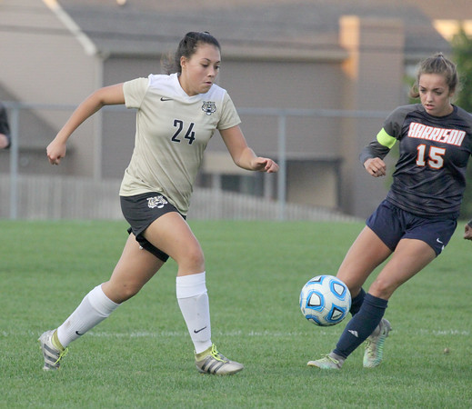 Lebanon's Brianna Martinez chases down a ball in the first half on Tuesday night.
