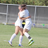 Western Boone's Madi Jones and Hillary Reed celebrate Jones' goal in the first half on Saturday.