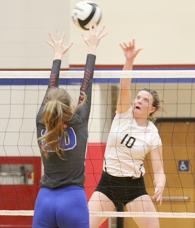 Lebanon's Kara Funk goes up for a kill over Western Boone's Regan Gubera on Tuesday.