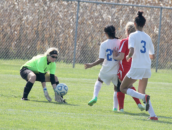 Western Boone goalkeeper Camryn Savage comes out to grab a ball in the first half on Saturday in the regional championship game.