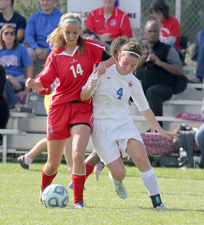 Western Boone's Hillary Reed and Cardinal Ritter's Emma Eifert battle for a ball in the regional championship game.
