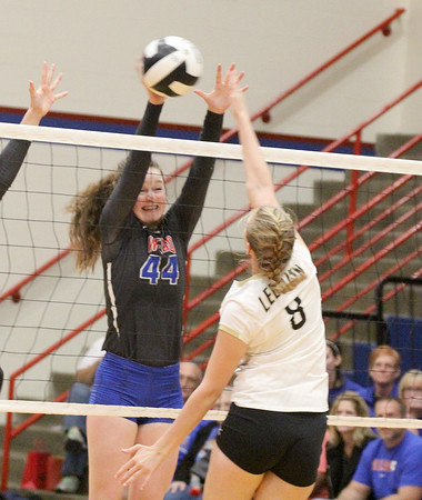 Callie Gubera goes up for a block against Tori Harker in the third set Tuesday night. Gubera was honored before the match as on of the Stars two seniors.