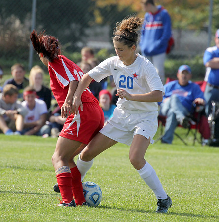 Western Boone's Olivia Hole takes the ball away from a Cardinal Ritter player on Saturday.