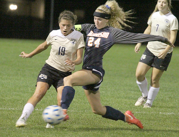 The Tigers' Sarah Perez tries to get past Harrison's Alexis DeCamp on Tuesday night in the sectional.