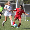 Lindsay Savage works to get the ball away from Cardinal Ritter's Phoebe Schrembre in the second half on Saturday.