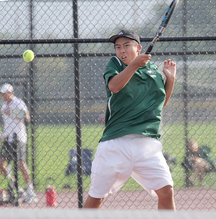Zionsville's Eddie Lin hits a forehand in his match at No. 1 singles on Wednesday in the regional final.