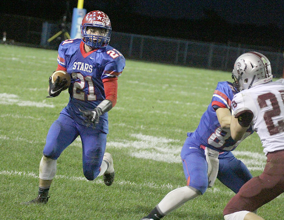 Nathan Bowman uses a block to gain more yards in the second half on Friday night.