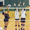 Zionsville's Megan Sheridan and Rori Wood go up to block North Central's Taylor Burns on Monday, Oct. 3.