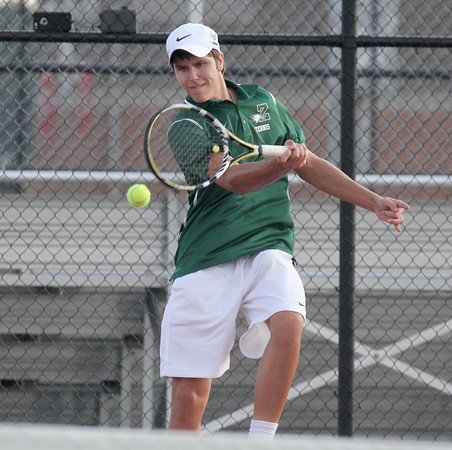 Kent Sadler his a shot in his match at No. 3 singles on Wednesday in the regional final.