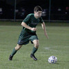 John Vlasak brings the ball up the field against Carmel on Wednesday.