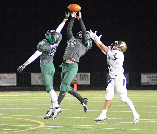Scott Rodgers and Tyler Milby defend a pass Friday night against Decatur Central.
