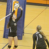 Kyleigh Robbins sets Tori Harker at the sectional match against Tri-West on Tuesday.