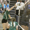 The Eagles' Tyler Horton gets a kill against Harrison in the third set on Thursday.