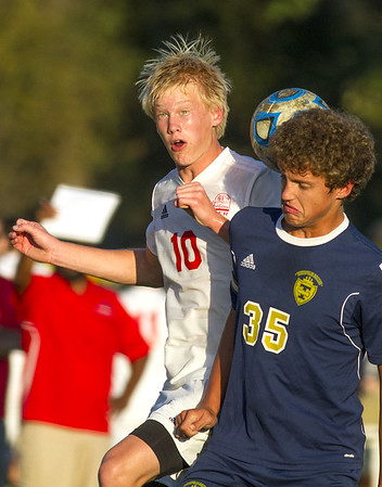 St. Anthony's Alex Deters and Teutopolis' Corey Schabbing compete for a header.