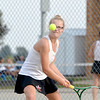 St. Anthony's Emilee Mossman keeps an eye on the ball as she prepares to hit a backhand during a match against Teutopolis' Christa Schwinke in Teutopolis.