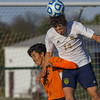 Teutopolis' Alex Probst, right, heads the ball above Beardstown's Jesus Avelino.
