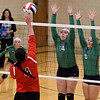 Chrisman's Hannah Eddy hits a spike while Windsor/Stew-Stras' Calla Roney (14) and Mackenzi Tabbert (8) set up a block during the Class 1A Stew-Stras Regional title game.