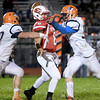 Effingham's Lucas Vasquez gets hit by Mahomet-Seymour's (L-R) Joshua Powell (70) and Skyler O'Connor (56) leading to an interception.