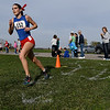 St. Anthony's Anna Sophia Keller leads the pack of runners during the second lap of the Class 1A Cross Country Sectional at Mid-America Motorworks.
