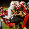 Effingham defensive back Grant Wolfe (left) makes a tackle along with Kendall Ballman and Alec Morrissey on Mt. Zion's Dawson Johns.