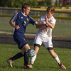 Teutopolis' Justin Vogt (left) and St. Anthony's Donovan Hammer (right) vie for control of the ball in Effingham.