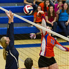 Newton setter Grace Hartrich (18) tips over Teutopolis' Macy Michels.