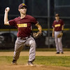 Dieterich's Paul Thoele attempts a pickoff at first during a National Trail Conference semifinal against St. Anthony.