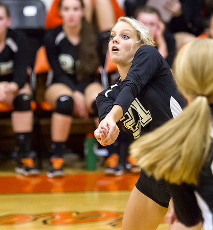 Altamont senior Hannah Paquette prepares to receive a serve during a senior night contest against Effingham.