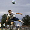 Teutopolis' Blake Kitten goes airborne after heading the ball during a sectional semifinal in Macon