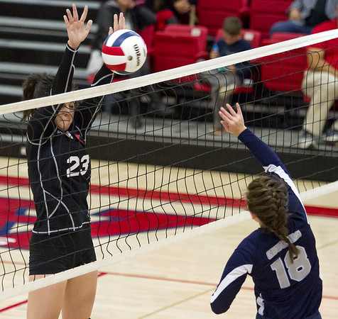 North Clay's Taylor Jones (left) blocks a hit by South Central's Hannah Rubin during the NTC volleyball tournament at St. Anthony high school.