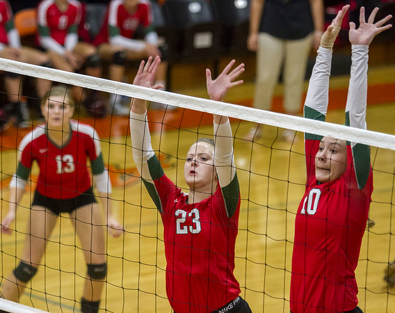 Effingham's Chloe Martin (23) and Kaitlyn Baker (10) go up for a block as Abbey Meinhart (13) looks on from the back row in Altamont.