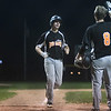 Altamont's Kolby Pemberton is greeted by Caden Miller at home plate after Pemberton's two-run homer in the top of the fifth, which gave the Indians a brief 5-3 lead over South Central.