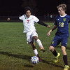 St. Anthony's Moises Lemus (left) and Teutopolis' Tyler Broom (right) battle for possession of the ball during the Class 1A Soccer Regional in Teutopolis.