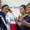 South Central head coach Mary Brimberry, right, speaks with her team during a timeout at the National Trail Conference volleyball championship.