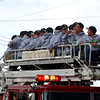 Members of the Teutopolis Junior High baseball team parade through town on a fire truck after the Wooden Shoes claimed their fourth-straight baseball state championship.