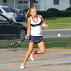 Teutopolis' Lauren Hemmen runs in and hits a forehand during a match against St. Anthony.
