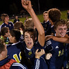 Teutopolis junior Alex Probst and senior Tyler Broom are swarmed by their teammates after a 3-2 victory against St. Anthony in the Class 1A Regional at Teutopolis Junior High School.
