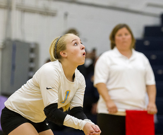Cumberland's libero Claire Guyon eyes the incoming ball in Teutopolis against Shelbyville.
