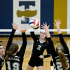 Cumberland's Skylar Brumleve (2) hits a ball through the defense of Altamont's Hanna Wolff (19, left) and Marlee Fearday (25, right) at the Class 2A Teutopolis Regional.