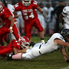10-12-12<br /> Cass vs Western football<br /> Blake Cain of Cass takes down Western's Hudson Featherstone during Friday night's football game.<br /> KT photo | Kelly Lafferty