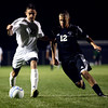 10-3-12<br /> Western vs. Logansport soccer<br /> Western's Cody Cox tries to get the ball away from Logansport's Jose Contreras during the soccer game on Wednesday night. Logansport won 2-1.<br /> KT photo | Kelly Lafferty