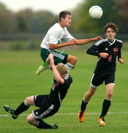 10-1-12 <br /> Boys Sectional Soccer<br /> Eastern HS vs Eastbrook HS<br /> Benjamin Bellow jumping over Eastbrook's Lucas Coyle while heading toward a shot.<br /> KT photo   Tim Bath